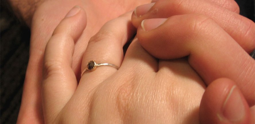 Us holding hands. You can see my engagement ring!